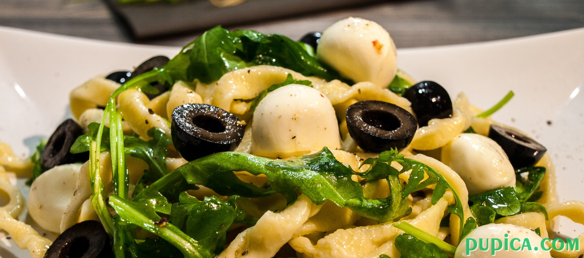 Pasta with Olives, Mozzarella and Arugula